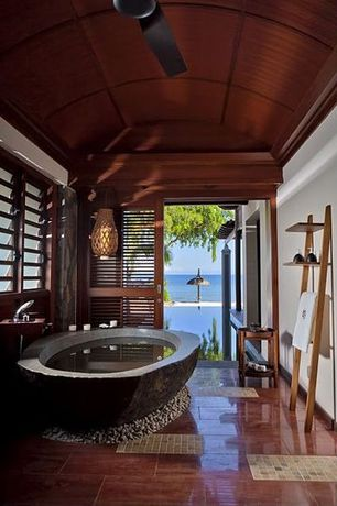 Tropical Master Bathroom with Artisan kraft brown coffee marble bathtub