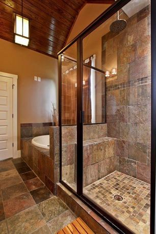Craftsman Master Bathroom with Master bathroom, Savona 60 inch by 42 inch oval bathtub, High ceiling, Pendant light