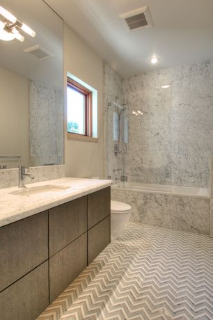 Contemporary Master Bathroom with shower bath combo, Complex Granite, wall-mounted above mirror bathroom light, Full Bath