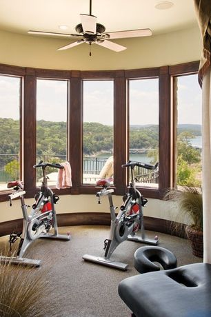 Contemporary Home Gym with Ceiling fan, Exerpeutic 250xl folding magnetic upright bike with pulse monitoring, picture window