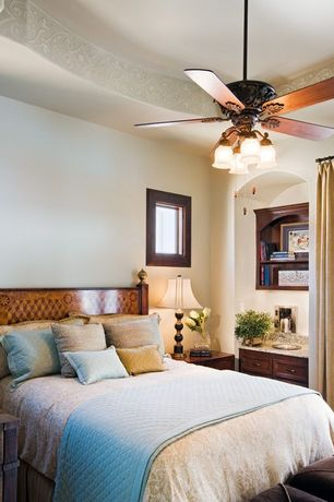 Traditional Guest Bedroom with Built-in bookshelf, High ceiling, Carpet, Ceiling fan