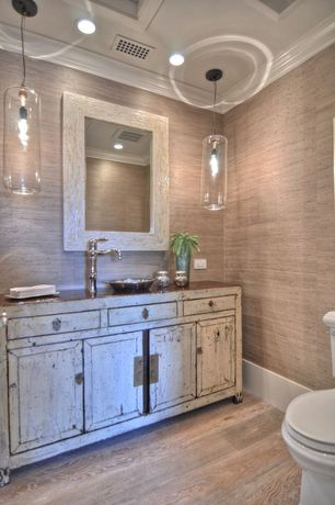 Cottage Powder Room with Crown molding, can lights, Pendant light, Powder room, Laminate floors, Wood counters, Vessel sink