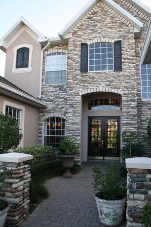 Traditional Front Door with Exterior stacked stone wall, Home loft concept elizabethan urn planter - color: antique clay