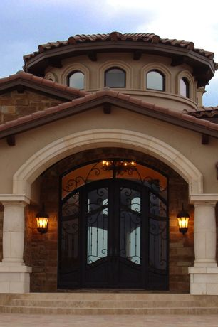 Mediterranean Front Door with Exterior brick, Arched window, Transom window, exterior stone floors, French doors