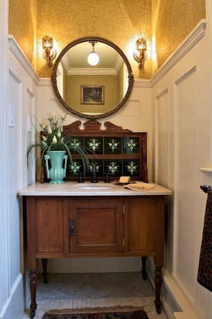 Traditional Powder Room with Wall sconce, Pendant light, Floral wallpaper, Wood paneling, Antique vanity with sink