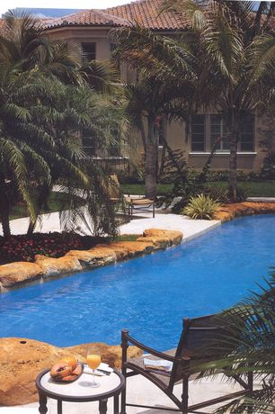Tropical Swimming Pool with exterior stone floors, Pathway