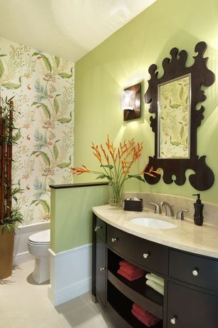Tropical Powder Room with Flush, Schumacher Annabelle Vine Pistachio Wallpaper, Wall sconce, interior wallpaper, Powder room
