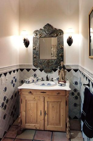 Eclectic Powder Room with Simple marble counters, Wall sconce, Raised panel, Powder room, Inset cabinets