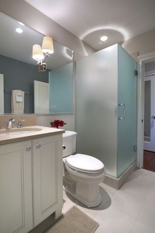 Contemporary 3/4 Bathroom with flat door, Daltile - glacier white 12 in. x 12 in. ceramic floor and wall tile, can lights