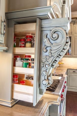 "Traditional Pantry with Wolf 48"" dual fuel range - 6 burners and infrared charbroiler, Custom detailed spice rack"