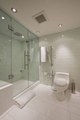 Contemporary Master Bathroom with frameless showerdoor, Handheld showerhead, Master bathroom