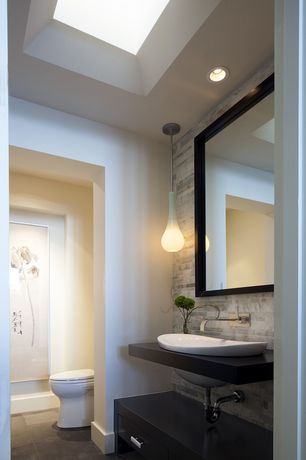 Contemporary Powder Room with Ceramic vessel sink, Soapstone counters, Stone tile wall, Flat panel cabinets, Inset cabinets
