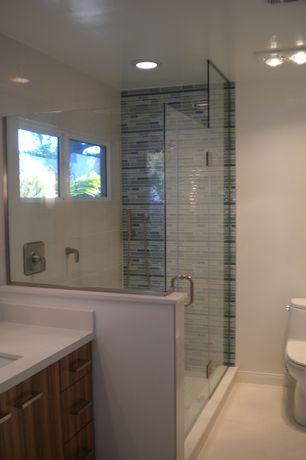 Contemporary 3/4 Bathroom with Quartz counters, American olean legacy glass ocean blend random linear mosaics lg44, Flush