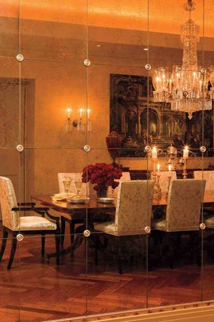 Traditional Dining Room with Chandelier, can lights, Built-in bookshelf, Wall sconce, flat door, Standard height