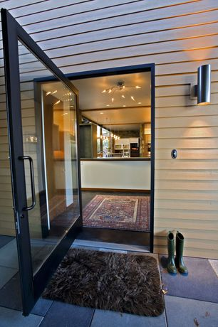 Modern Front Door with French doors, exterior tile floors