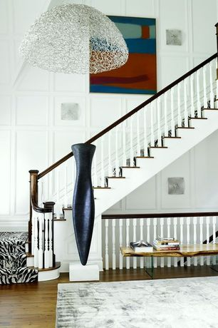 Contemporary Staircase with curved staircase, High ceiling, Hardwood floors, flush light, Wall sconce