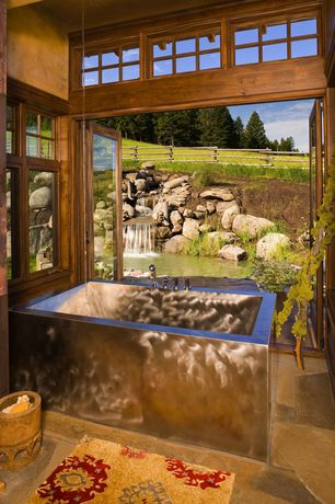 "Rustic Master Bathroom with Transom window, 48"" amery polished stainless steel soaking air tub, French doors, Master bathroom"