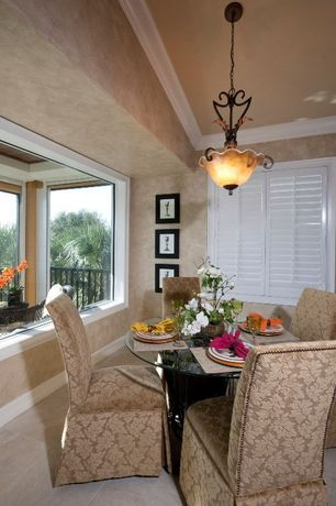 Traditional Dining Room with Crown molding, flush light, Concrete tile