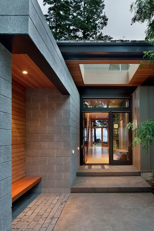 Modern Exterior of Home with Concrete walkway, Concrete, Oldcastle Gray Solid Concrete Brick, Coates design, Transom window