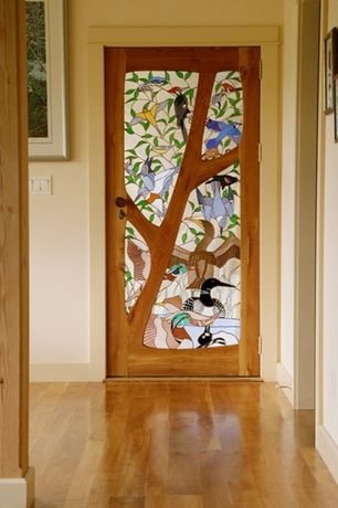 Eclectic Entryway with Stained glass door, Paint, African celtis light hardwood flooring