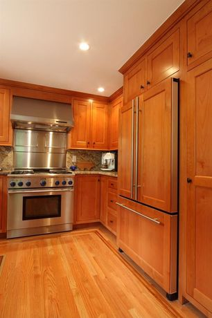 Craftsman Kitchen with Framed Partial Panel, Complex Granite, Standard height, full backsplash, gas range, can lights