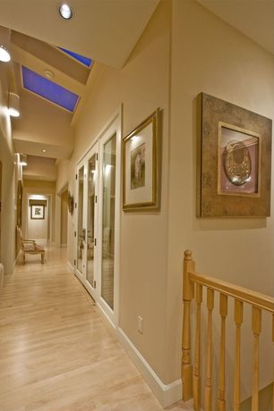 Eclectic Hallway with High ceiling, Columns, French doors, Laminate floors