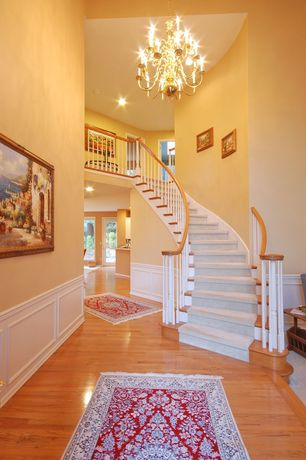 Traditional Staircase with High ceiling, Chandelier, Hardwood floors