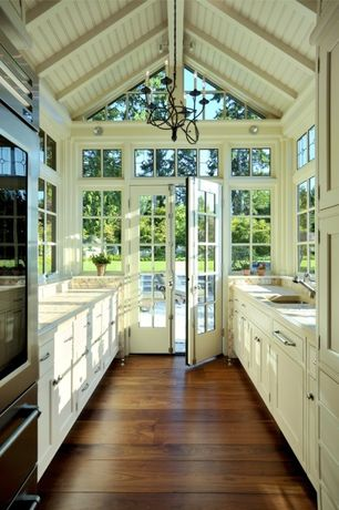 Cottage Kitchen with Crown molding, Simple Granite, Quorum Anatola 5 Light Candle Chandelier, Flush, Exposed beam, Galley