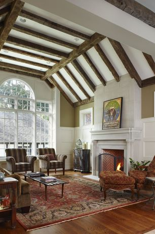 Traditional Living Room with Wainscotting, High ceiling, Hardwood floors, Exposed beam, Casement, can lights, Fireplace