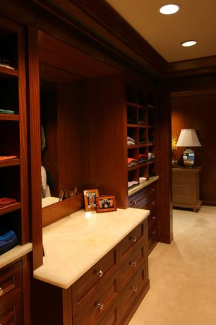 Traditional Closet with Standard height, Crown molding, Concrete floors, can lights, Built-in bookshelf