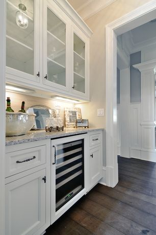 Traditional Kitchen with Inset cabinets, Glass panel, Wine refrigerator, flush light, Crown molding, One-wall, Stone Tile