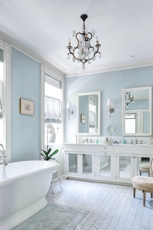 Cottage Master Bathroom with Shades of light soho sconce, Bathtub, Complex Marble, partial backsplash, Glass panel, Paint 1