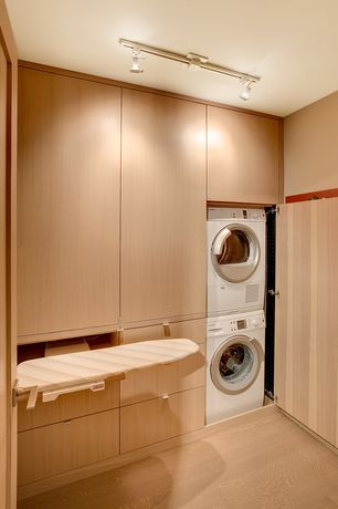 Contemporary Laundry Room with Drop-in sink, Standard height, Laminate floors, Ironing Board, flush light