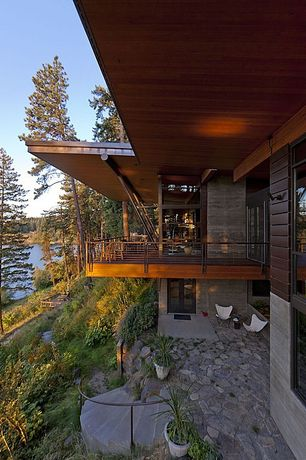 Contemporary Deck with Pathway, exterior stone floors, French doors, Transom window, Deck Railing, picture window