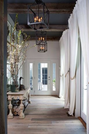 Traditional Entryway with Exposed beam, French doors, Chandelier, picture window, Standard height, Hardwood floors