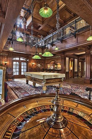 Traditional Game Room with Balcony, Wall sconce, Arched window, can lights, Box ceiling, Hardwood floors, Pendant light