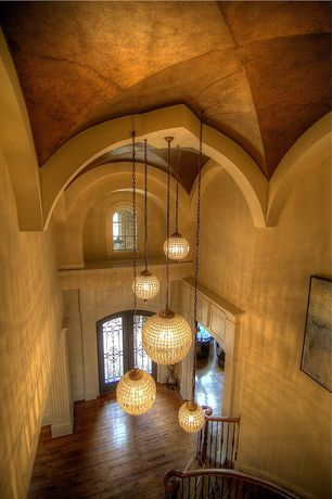 Mediterranean Entryway with Arched ceiling, French doors, Hardwood floors, Arched window, Wrought iron railing