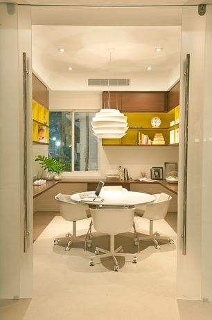 Contemporary Home Office with Chandelier, Concrete floors, Built-in bookshelf, specialty door