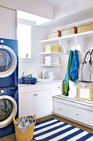 Traditional Laundry Room with Crown molding, sandstone tile floors, Painted wood panel wall, Electrolux iq touch washer dryer