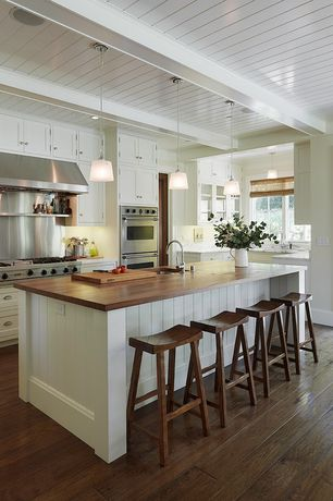 Cottage Kitchen with L-shaped, Pendant light, Simple marble counters, Wood counters, Kitchen island, Exposed beam