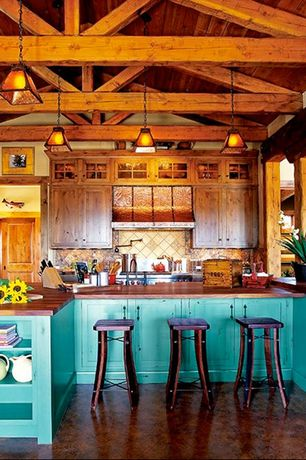 Craftsman Kitchen with L-shaped, Flat panel cabinets, Pendant light, electric cooktop, Seattle copper stove hood, Custom hood