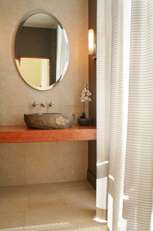 "Modern Powder Room with Powder room, John boos 3"" thick american cherry island tops, Wall sconce, stone tile floors"