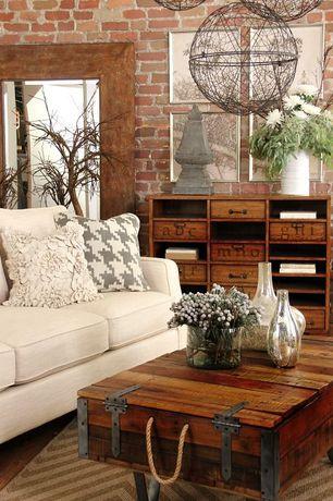 Living Room with Pendant light, Hardwood floors, High ceiling, interior brick