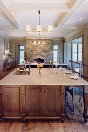 Cottage Kitchen with Undermount sink, Box ceiling, One-wall, Corian counters, Kitchen island, Pendant light, specialty door