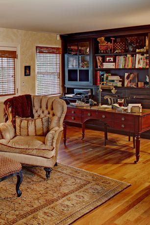 Traditional Home Office with Hardwood floors, Built-in bookshelf, Glass panel door, interior wallpaper, double-hung window