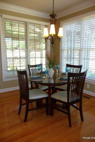 Traditional Dining Room with High ceiling, Casement, Hardwood floors, Chandelier, Crown molding