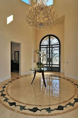 Traditional Entryway with Arched window, simple marble floors, Chandelier, Glass panel door, High ceiling