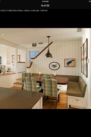 Cottage Dining Room with Capital Lighting 1 Light Mini Pendant, Hardwood floors, Bernhardt Dining Room Dining Table, Columns