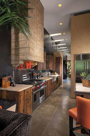 Contemporary Kitchen with One-wall, Wolfe - 6 burner + griddle, double oven, Flush, High ceiling, Limestone counters