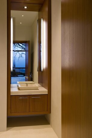 Modern Powder Room with Flush, large ceramic tile floors, Powder room, Vessel sink, Corian counters, European Cabinets